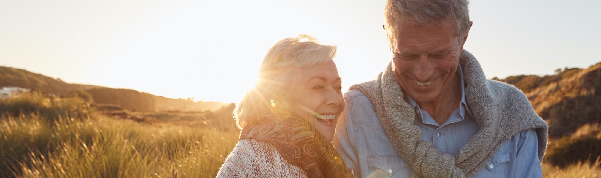 Photo of two seniors enjoying the sunset